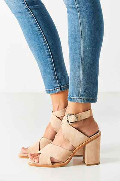Even if you've got no rhythm, these sweet heels from Sol Sana will have you feeling like a dancer. Banded strappy upper in a soft, femme suede with adjustable buckled ankle straps + peep-toe. Fitted on a sloping sole with a covered rubber-coated block heel.