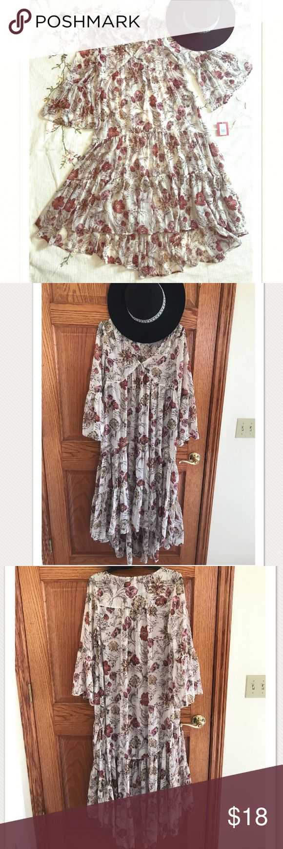 NWT!💕 Flowy Hippie Boho Floral Festival Dress! 💕 NWT gorgeous Mossimo dress size small in a beautiful ivory/cream floral print with open flowy sleeves and ruched tiers down the skirt. Slight hi-lo hem and a little sheer so it would be perfect with a slip dress or cute bodysuit underneath! Size small but it is looser and flowy, I usually wear a large and it fit fine on me! The perfect layering piece for any hippie boho music festival! In perfect condition with no flaws! 💕 Mossimo Supply…