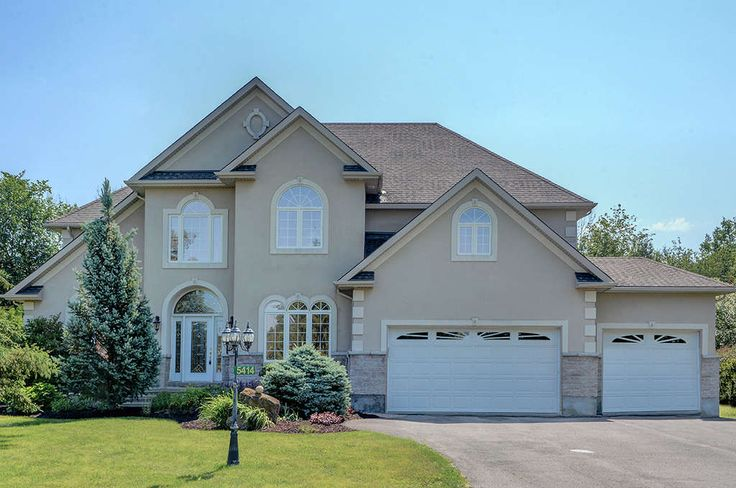 Manotick Estate 1,059,000 ID#22506 Premium ravine oasis lot w/kitchen, hot tub, fenced in heated salt water pool, changing rm & 3 pce bath. Custom quality home w/many upgrades. Come & see this winner