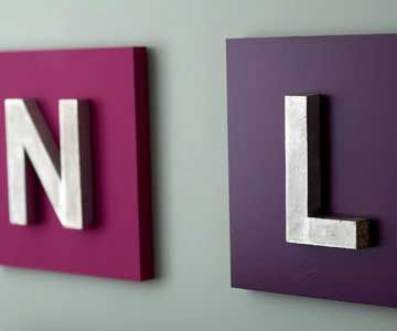 Salvage or new letters screwed onto painted wood squares.