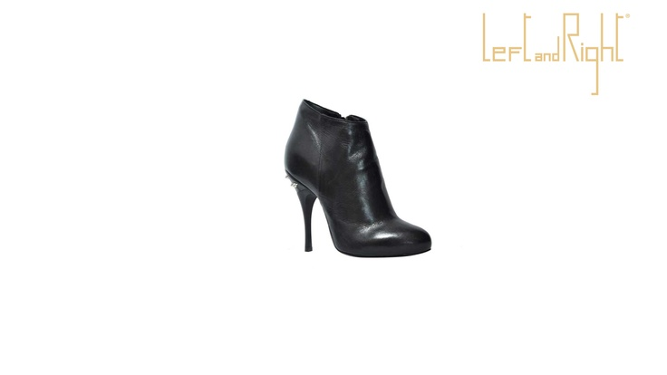 ankle boot black leather, 10 cm heel, leather sole with rubber injection on the plant, brass studs.