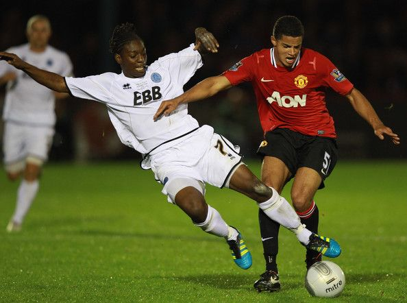 Jermaine McGlashan tussles with Ezekiel Fryers in  Aldershot Town v Manchester United Carling Cup Fourth Round tie