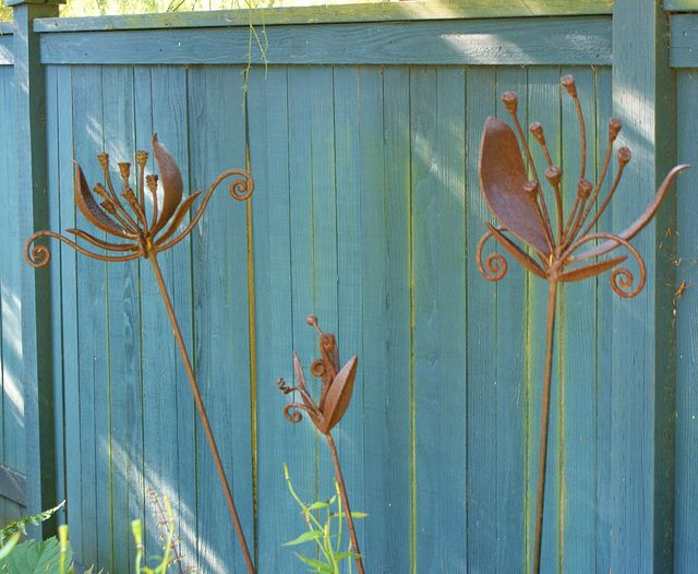 Metal garden art, how pretty these look.
