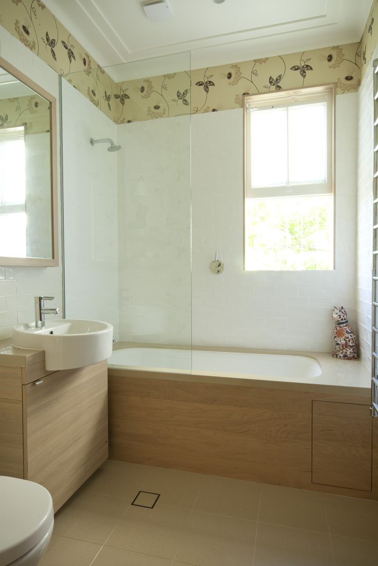 Bathroom With Neisha Crosland wallpaper and timber cladding. Brooke Aitken Design.