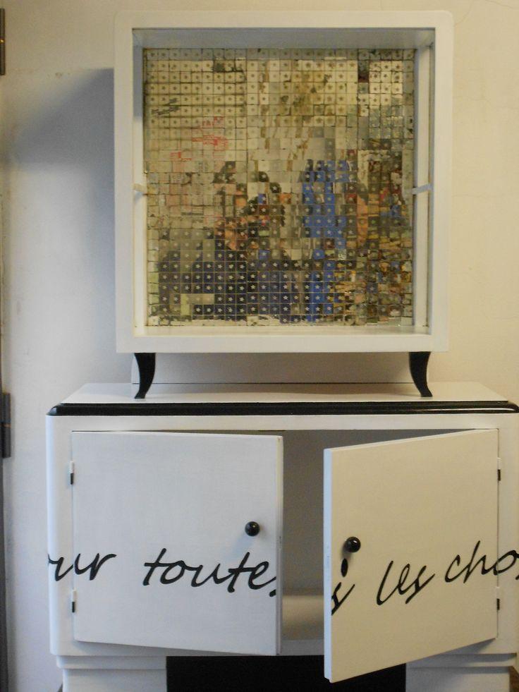 mobile con specchi a mosaico