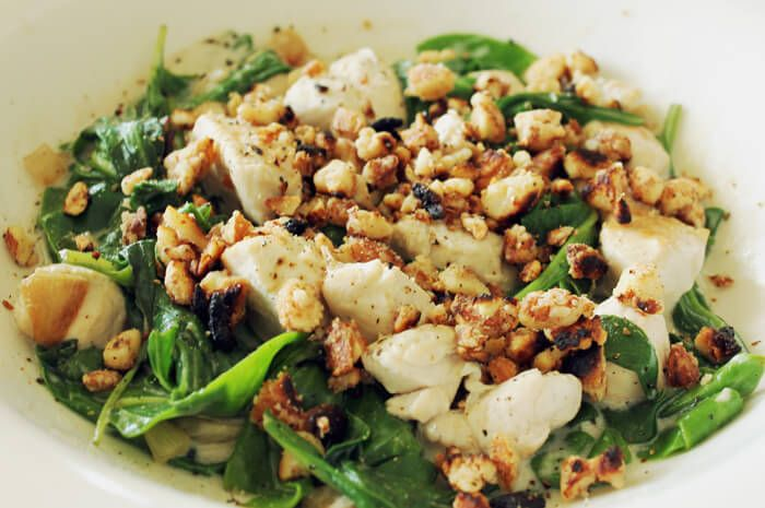 A coconut chicken recipe garnished with toasted almonds. This is a meal that is satisfying, high in protein and perfect for a Candida diet.