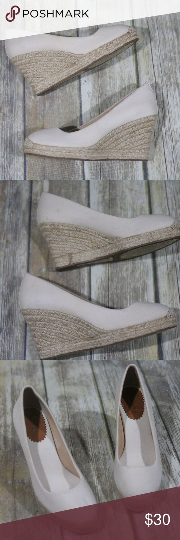 """J. Crew Canvas Espadrille Wedge Seville A1244 J. Crew Factory Women's Canvas Espadrille Wedge Shoes.  (Resemble the Seville, but I think these may be the factory comparable).  Size 7.  Style A1244.  Beige.  Canvas upper.  3 3/4"""" heel.  Rubber sole.  In good, preowned condition.  There are a few scuffs and faint water marks.  Very little wear to bottoms.  No trades, offers welcome. J. Crew Shoes Wedges"""