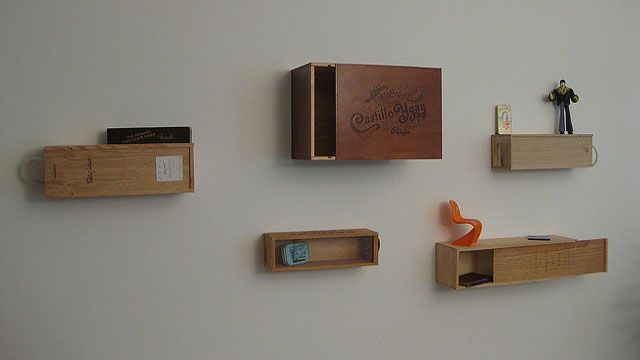 http://lifehacker.com/5799575/use-empty-wine-crates-for-easy-wall+mounted-storage