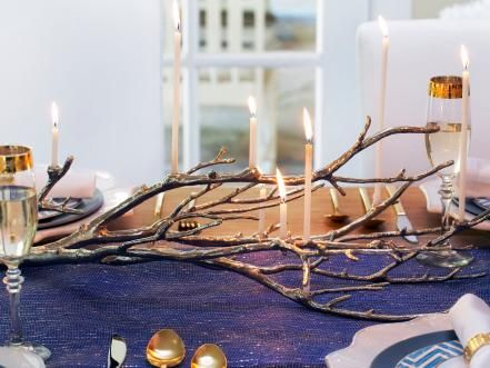 Bring modern style and sophistication to your Hanukkah table with a mix of metallics and layered blues.