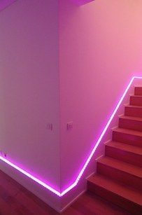 Play around with neon light strips to create surreal effects. | 23 Subtle Yet Bold Ways To Add Color To Your Home