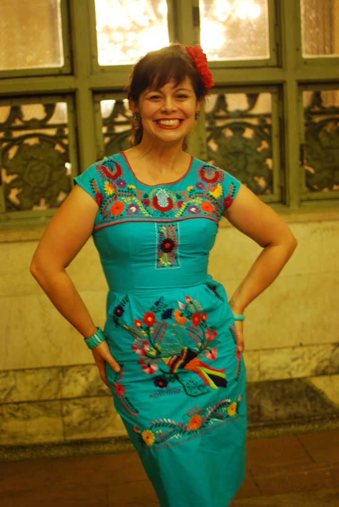 refashioned mexican dress! Only I'd remove the sleeves and make it shorter. Wear an updo with a large flower. Do pinup style makeup. Shoes... up in the air :/