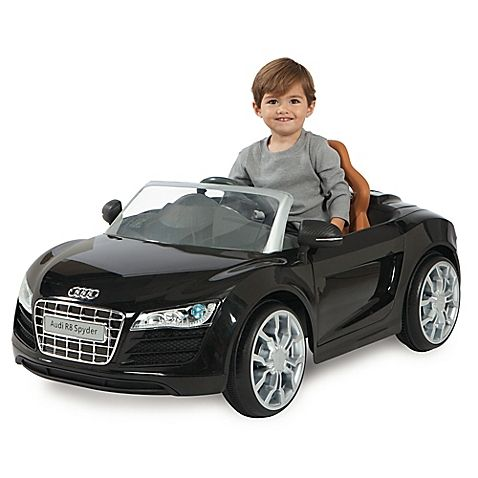 The sleek body and fine interior of this Audi R8 Spyder put your child in the driver's seat of premium ride-on fun. Its sporty design features a working horn and headlights, and realistic engine sounds that make it an extra-exciting ride for kids.