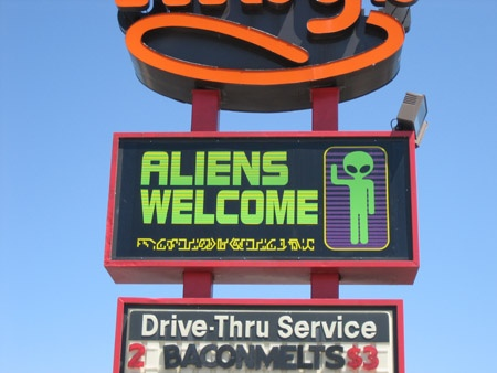 Roswell, NM   (pic from slideamerica blog)  If you visit here, make sure to get your alien tattoo at Romeros
