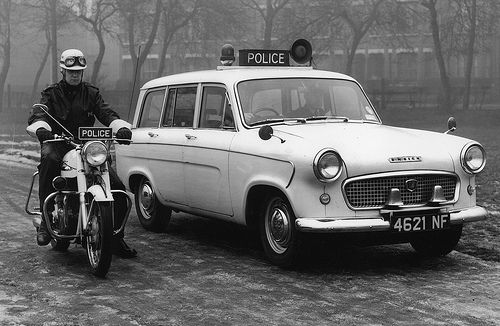 A Standard Ensign estate car and police motorcycle of the Manchester City Police fleet in 1962. The Ensign was used as patrol car that was able to carry a large amount of emergency equipment to the scenes of accidents.  In 1962, 4622 people were killed or injured on the roads of Manchester. http://www.gmpmuseum.com