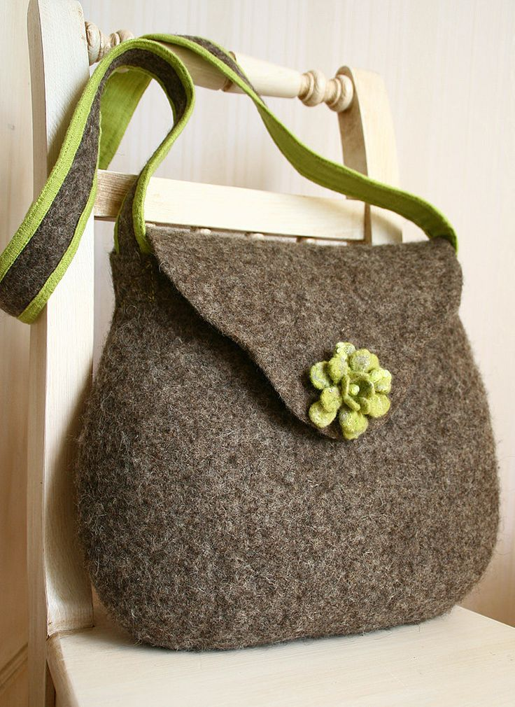 I LOVE the shaping of this bag, and I do like the flower.