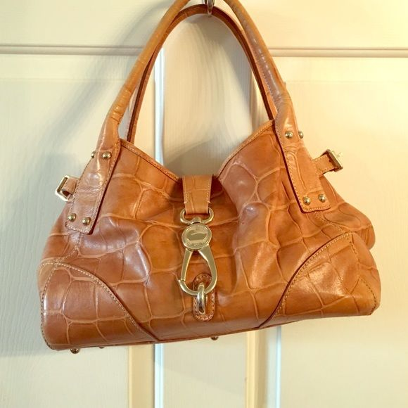 Donney and Burke bucket bag Tan nice leather. Barely used. Great structured summer bag. Dooney & Bourke Bags Shoulder Bags