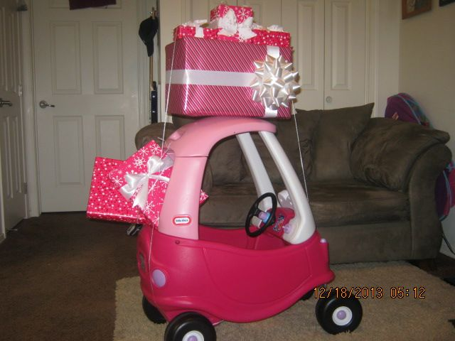 """I liked the pictures of kids in their cars with the Christmas tree on top and decided to """"girl"""" it up for my 1 year old daughter. (Car with presents) (Cozy Coupe) (Christmas picture idea) Kids Christmas pic"""