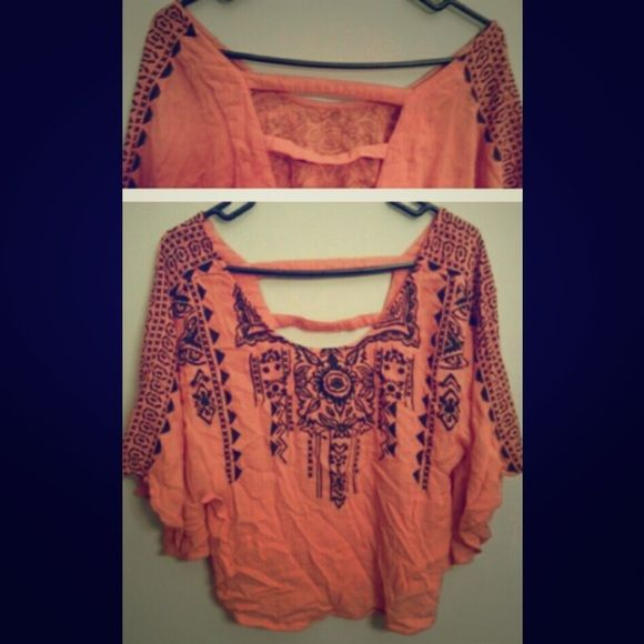 Orange Batwing Top Orange batwing top with stylish cutouts on the back and gorgeous black designs on the front and sleeves. Tops