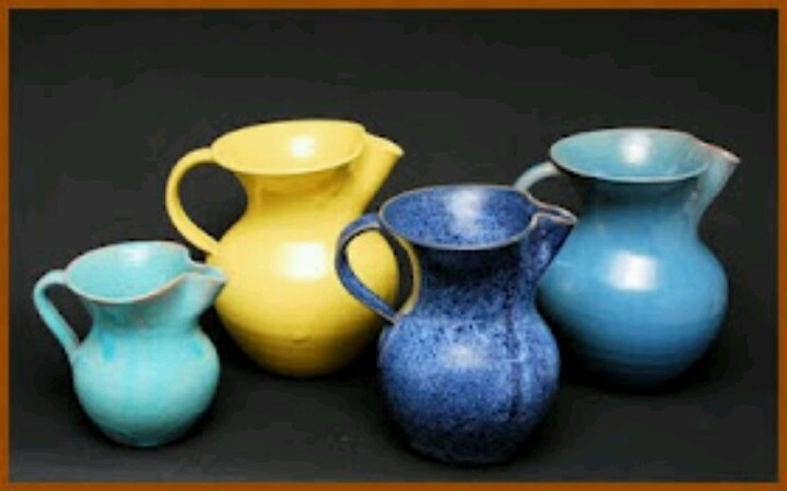 Four pitchers by Phil Graves of J. B. Cole Pottery. The two in front are from the 1930s, made with Michfield light clay; the two in back are post-WWII, made with Smithfield redware clay.