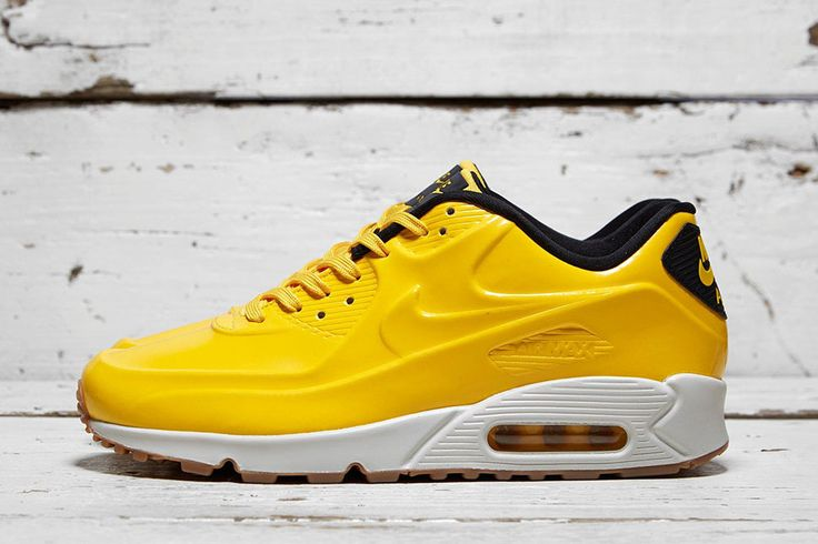 The latest Nike Air Max 90 release is encased in a Vac-Tech shell. Built on a gum sole, the kicks have a varsity maize upper with black detailing. The kick