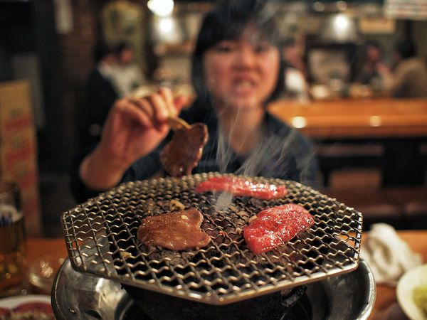 Yakiniku is Japanese style bbq. You cook your own meat and vegetables over a coal grill in your table. It's satisfying at a primal level to sit around a fire with friends and cook some meat.