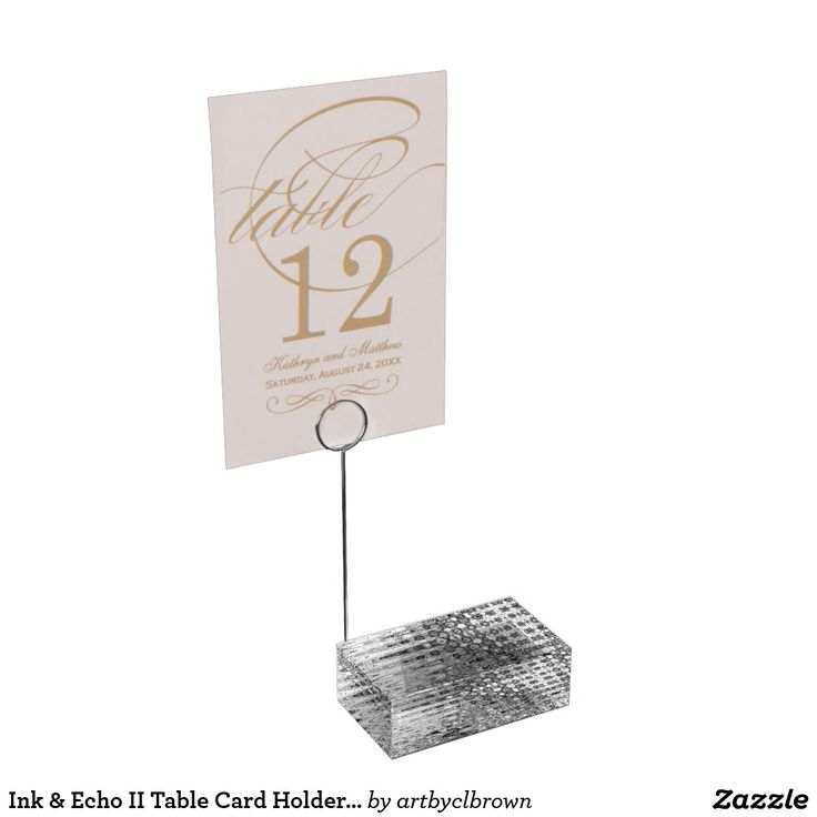 "The Ink & Echo II Table Card Holder designed by Artist C.L. Brown features an abstract kinetic light painting design enhanced with Photoshop. The perfect complement to your table cards, this high quality artist designed table card holder is sturdy and sleek. This high quality acrylic base with stainless steel metal card holder is perfect for your wedding or special event.Dimensions: 1.75""l x 3""w x 1""h (Acrylic base); 5""h (Total height with base)."