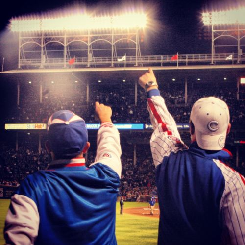 #Cubs fans root, root, root for the home team at Wrigley Field... This reminds me of growing up near Chicago and getting to go to cubs games when I was their age! So cute! Go Cubbies!