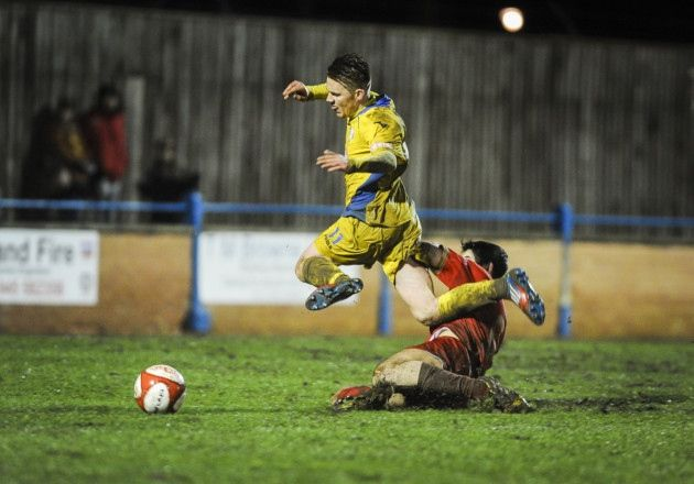 Action from King's Lynn Town v Ilkeston at The Walks - Jake Jones is fouled for the penatly Picture: Matthew Usher.