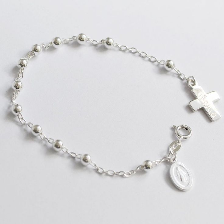 Pulsera rosario de plata con virgen y cruz grabada