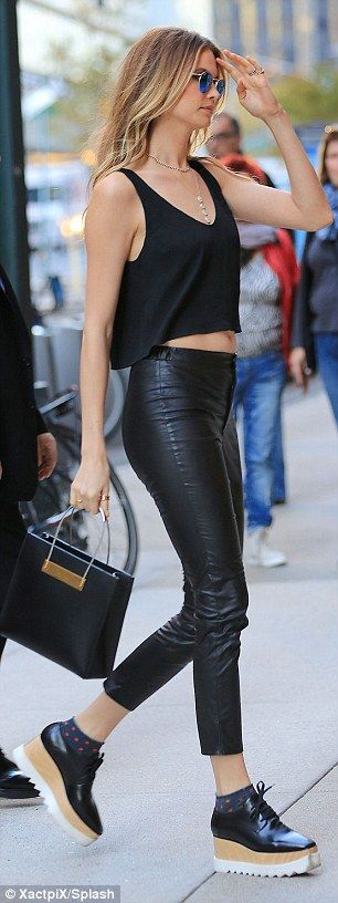 Stepping out: The supermodel wore a pair of comfy platform shoes on her outing...
