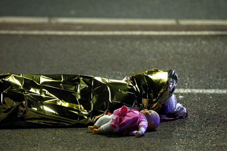 Pictures of the Year 2016:     Terror Attacks ‐ Nice:     A body is seen on the ground July 15, 2016 after at least 30 people were killed in Nice, France, when a truck ran into a crowd celebrating the Bastille Day national holiday July 14.