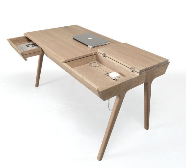 Designed by Gonçalo Campos, this electronic-ready desk is made of solid wood with compartments and workspace on both sides so two people can work together.