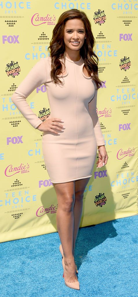 Rocsi Diaz from 2015 Teen Choice Awards Red Carpet Arrivals  In a nude long-sleeved bodycon, the star shows off her toned physique.