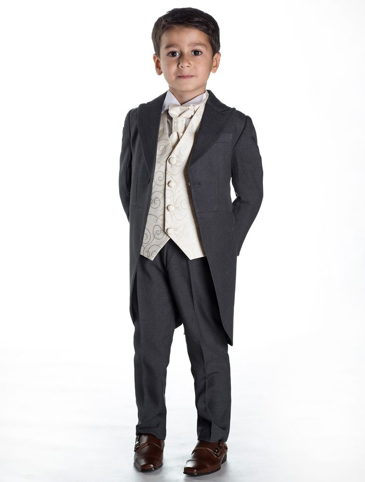 A smartly presented boys grey tail suit with complementing ivory waistcoat, cravat and pocket square. http://www.paisleyoflondon.co.uk/stockists/
