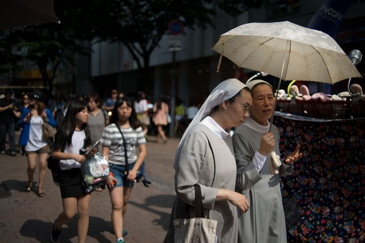 South Korea- 15% atheist Nuns walk on a popular shopping street in Seoul on July 6, 2013. Freedom of religion is constitutionally guaranteed in South Korea, which is predominantly Buddhist and Christian.