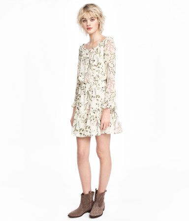 Natural white/patterned. Dress in chiffon with a printed pattern. Wide, drawstring neckline and long raglan sleeves with flounced cuffs. Narrow elasticized