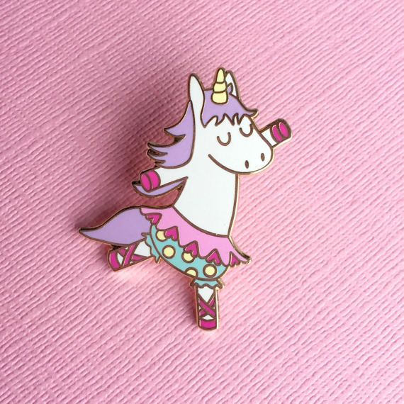 Dancing Unicorn Pin - Hard enamel kawaii pin  This super cute pin is perfect on any collar, bag, hat, scarf or on a cork board! Its lovely pastel colours and its shiny gold metal structure make it a perfect gift for ladies of any age!  The hard enamel pin measures 3.5cm high (approx 1.4), has gold metal structure and a rubber clutch on the back to pin it securely wherever you wish. It comes carefully packaged, on a cute exclusive backing card.  Find more pins by Box Monster here…