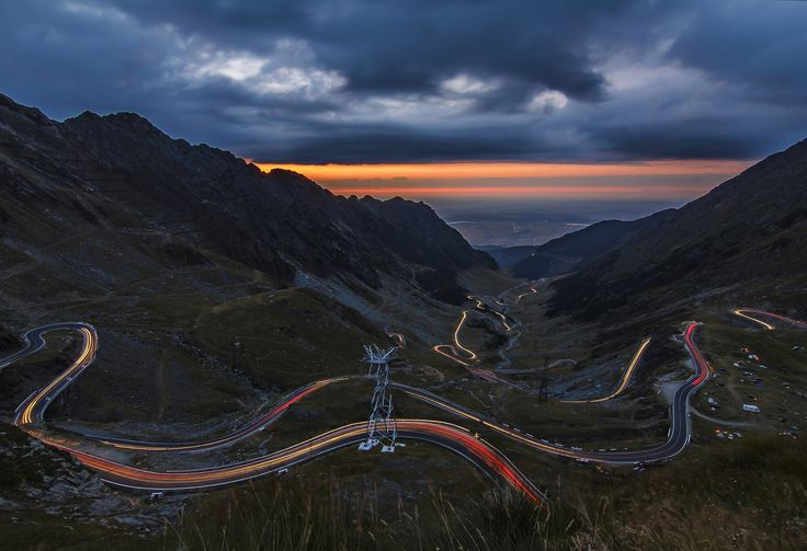TransFagarasan - The Transfăgărășan (trans (over, across) + Făgăraș) or DN7C is the second-highest paved road in Romania. Built as a strategic military route, the 90 km of twists and turns run north to south across the tallest sections of the Southern Carpathians, between the highest peak in the country, Moldoveanu, and the second highest, Negoiu. The road connects the historic regions of Transylvania and Wallachia, and the cities of Sibiu and Pitești.The road climbs to 2,034 metres…