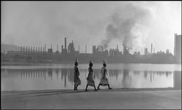 Werner Bischof 1954, INDIA. Town of Jamshedpur. May 1951. Employees of the Tata Iron and Steel Company on their way to work. The industrial complex was founded in 1907 by Jamshedji Nassarwanyi TATA. Over the years it became the nucleus of a huge complex producing textiles, steel, electric power, chemicals, agricultural equipment, trucks, locomotives, and cement. The TATA family was also the largest private funder of technical education and scientific research in India. 1951.