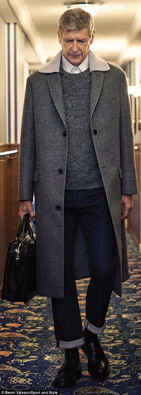 Wenger in a long, grey coat...