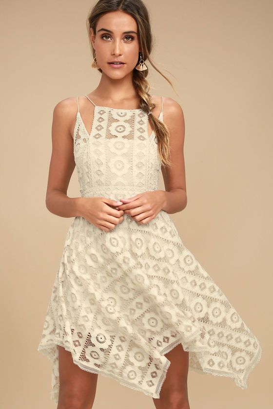 The Free People Just Like Honey Beige Lace Dress is as sweet-as-can-be! Romantic lace overlay forms this sleeveless dress with a unique, high neckline, and crochet lace princess seams. Skirt falls to flirty length with handkerchief hem. Braided double straps and hidden back zipper/clasp.