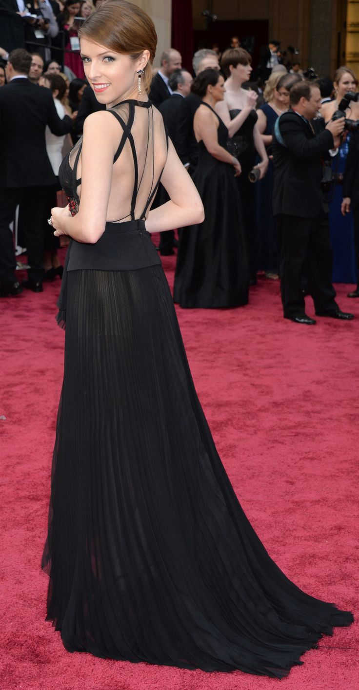 Anna Kendrick in a sheer paneled black dress on the Academy Awards red carpet. #oscars