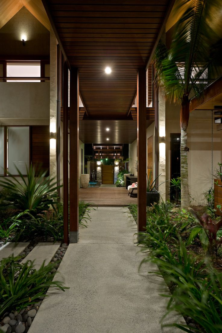 Entry way into a beach-front, Balinese inspired, family home located in Salt Village, Kingscliff, New South Wales, Australia. Built by Seabreeze Homes. Designed by Grounds Kent Architects.