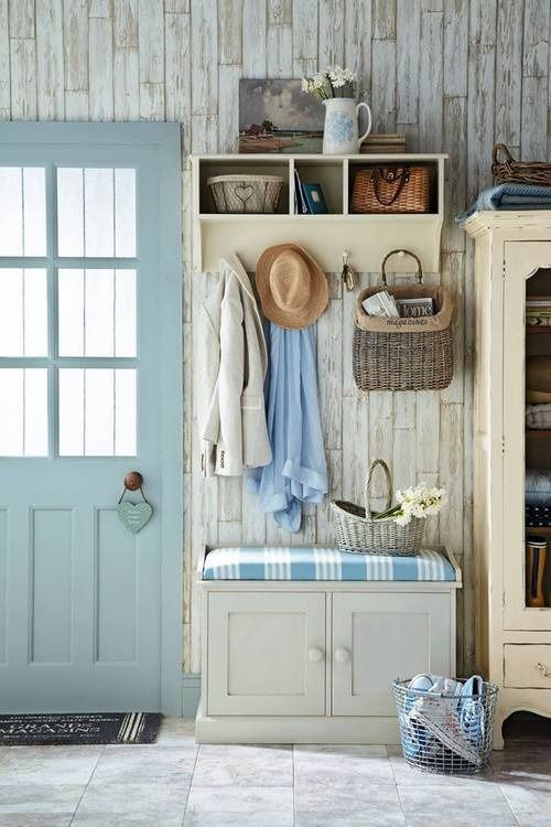 Stunning coastal/ country entrance hall. Love the blue of the farmhouse door, picked up by the blue fabric of the seat pad. If you like this pin, why not head on over to get similar inspiration and join our FREE home design resource library at www.FlorenceAndFreya.com?