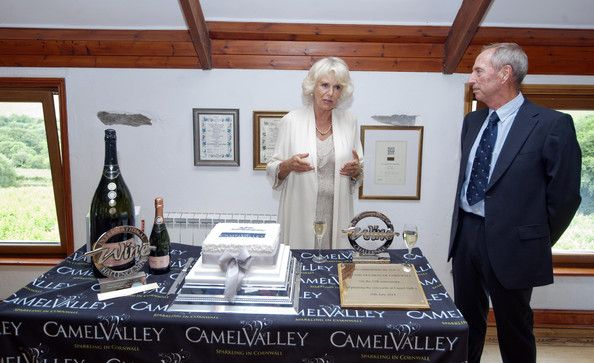 Camilla, Duchess of Cornwall is seen with Bob Lindow of Camel Valley whilst on a vist to the Camel Valley vineyard near Bodmin on July 16, 2014 in Cornwall, England. The restaurant which is managed by Cornwall Food Foundation are training unemployed young people as chefs.