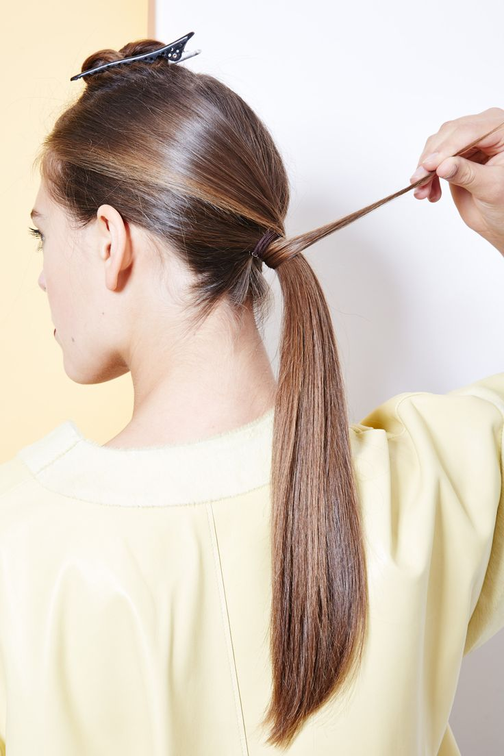 Undo the smaller section of hair, and wrap it around the base of your ponytail, pinning it in place.