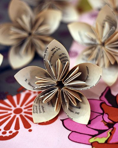 Paper Flower Tutorial-way cuter than the old school tissue flowers.  This is ADORABLE.  I LOVE how this one shows to use pages from an old book!!!!  We can always find old books at thrift stores for beyond cheap!!!