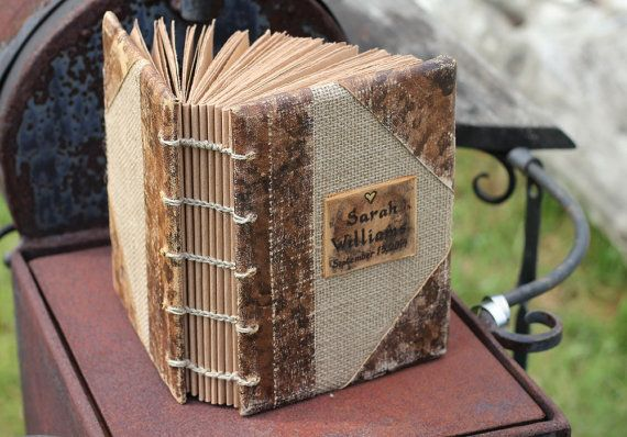 Rustic burlap and leather journal, blank book is made from burlap and painted leather. The paper is recycled brown craft paper, hand torn and bound with strong waxed linen thread. The journal has 180 sheets (360 if count both sides). Paper 80 g/m2 Measures 8,7 x 6,5 nches or 22,3 x 16,,3 cm  You can choose only journal or journal with pen holder.  If you like old look this book is for you! I will engrave your names or initials on the book. If you dont want the little heart on the top, le...