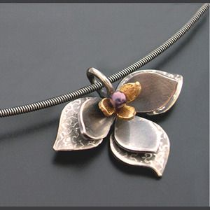 "Aileen Lampman | ""Lotus Pendant"" layered in sterling, 14k and purple cultured pearl. Strung on a 16"" sterling cable neck wire (pictured) or scalloped chain."