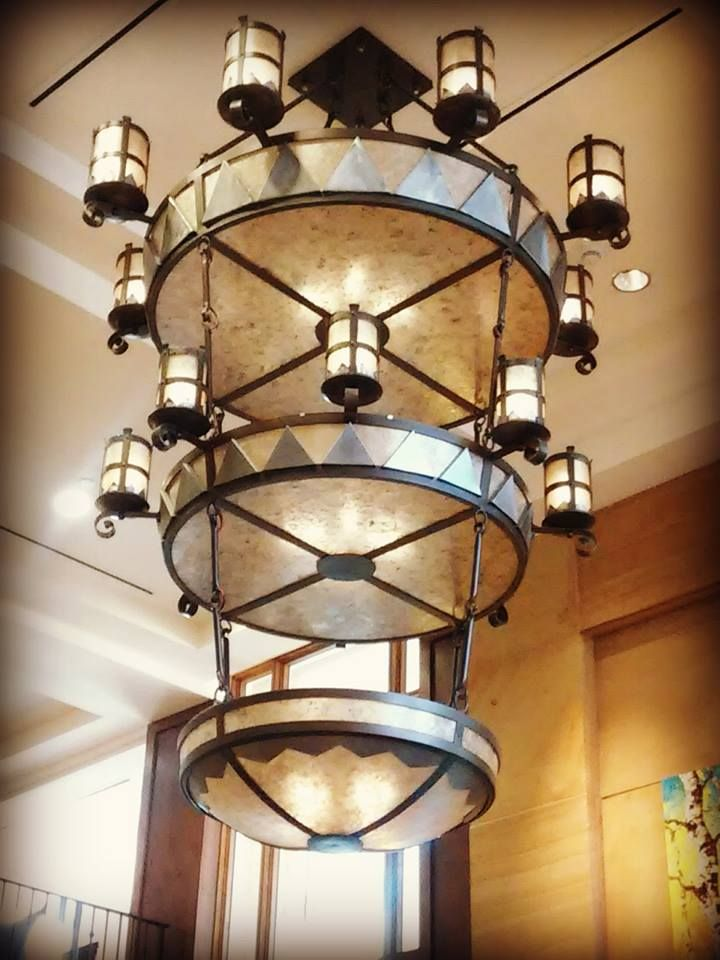 Large southwestern chandelier hanging in lobby of Drury Plaza Hotel in Santa Fe, NM